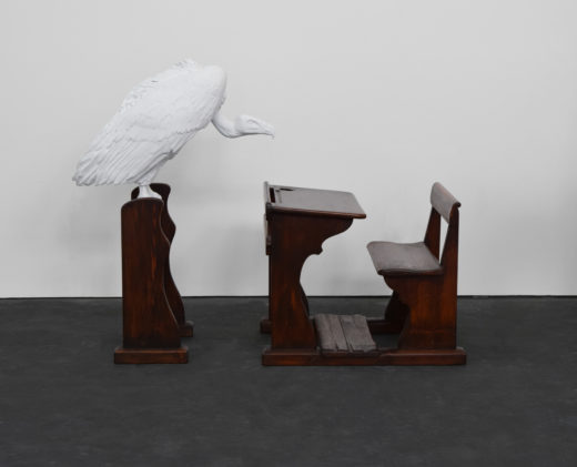 ABC, 2015. Epoxy resin vulture with matte white lacquer finish, antique school desk. 115 x 150 x 60 cm